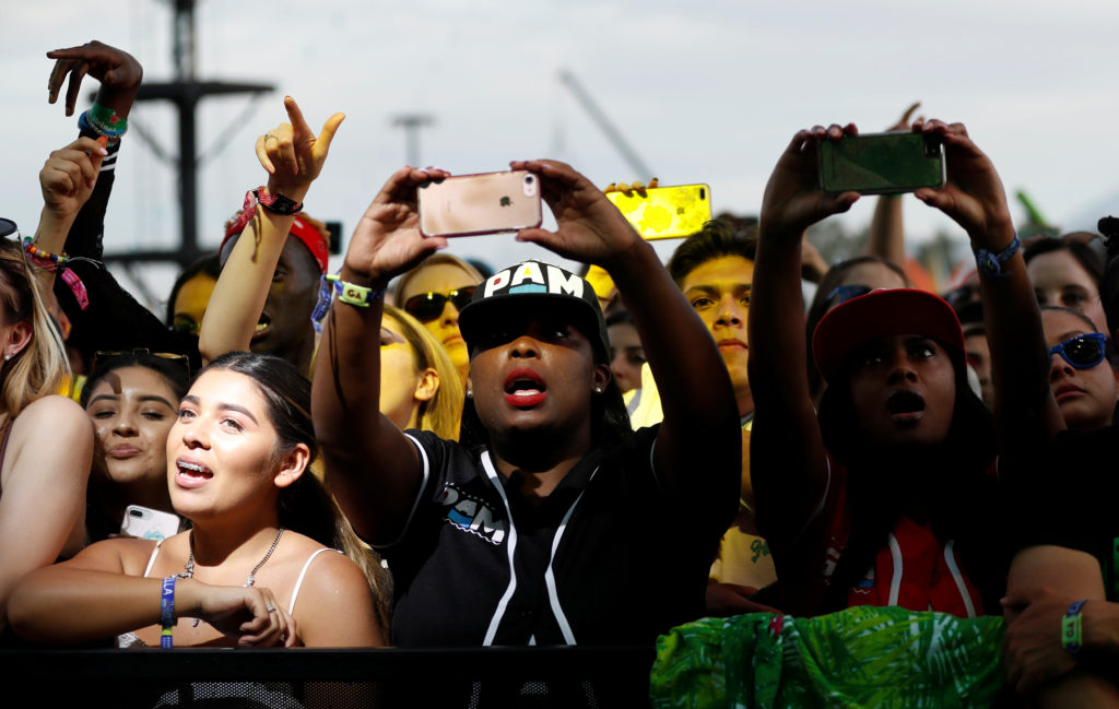 Concertgoers watch a performance by Cardi B at the Coachella Valley Music and Arts Festival in Indio, California, U.S., April 15, 2018.  REUTERS/Mario Anzuoni - RC1797C8D160