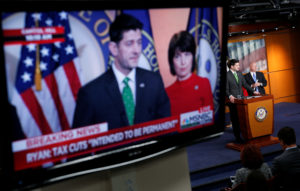 Speaker of the House Paul Ryan (R-Wisc.) is shown speaking on a monitor about tax cuts during a media briefing on Capitol Hill in Washington, D.C. Photo by Joshua Roberts/Reuters