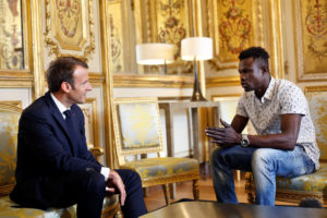French President Emmanuel Macron (left) meets with Mamoudou Gassama, 22, from Mali, at the Elysee Palace in Paris on May 28. Photo by Thibault Camus/Pool via Reuters