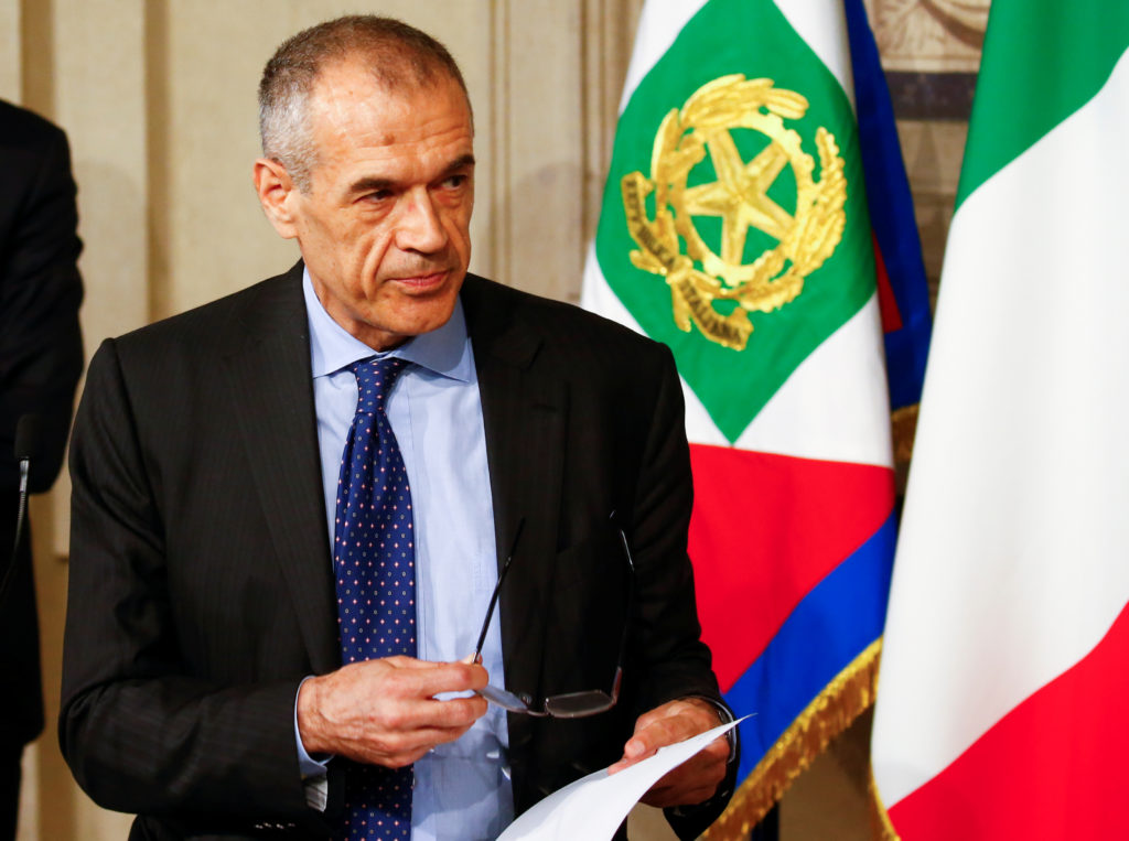 Former senior International Monetary Fund official Carlo Cottarelli speaks to the media after a meeting with Italy's Presi...