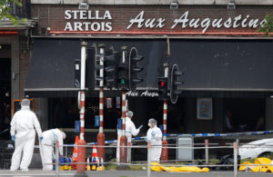 Forensics experts are seen on the scene of a shooting in Liege, Belgium. Photo by Francois Lenoir/Reuters