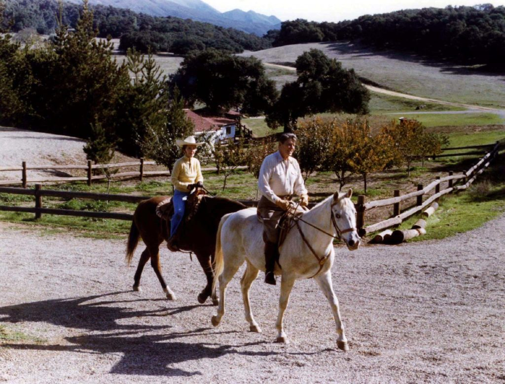 Ronald and Nancy Reagan ride horses on their Santa Barbara Ranch, known as Rancho del Cielo, in this file photo taken during Reagan's presidency. Photo by Reuters