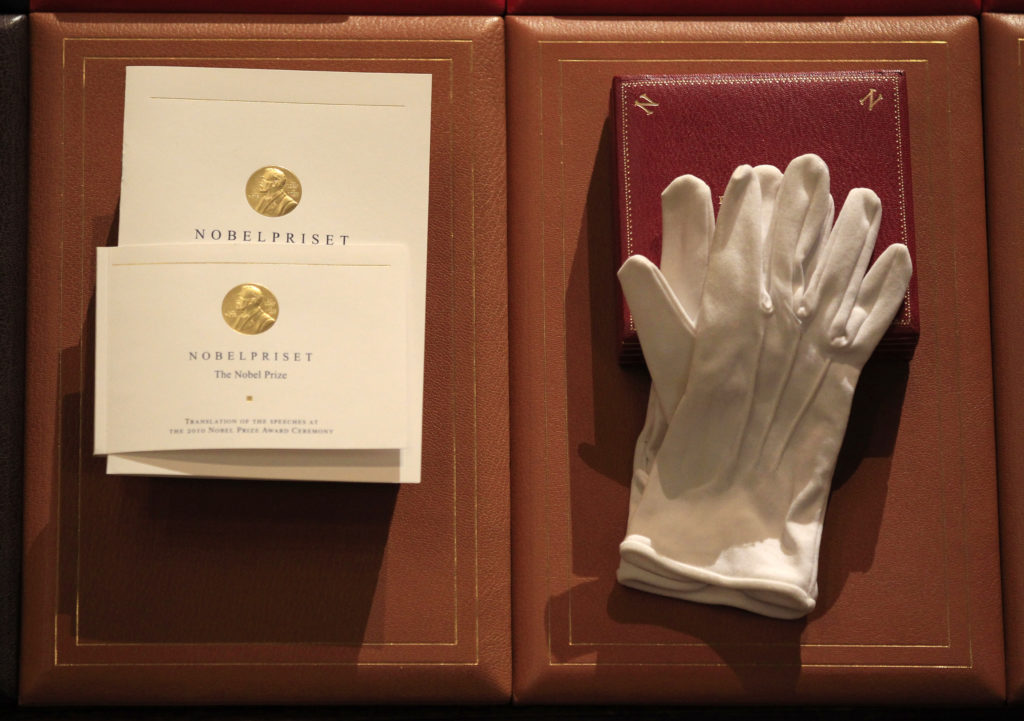 Prizes for the 2010 Nobel Prize winners are seen before the award c…
