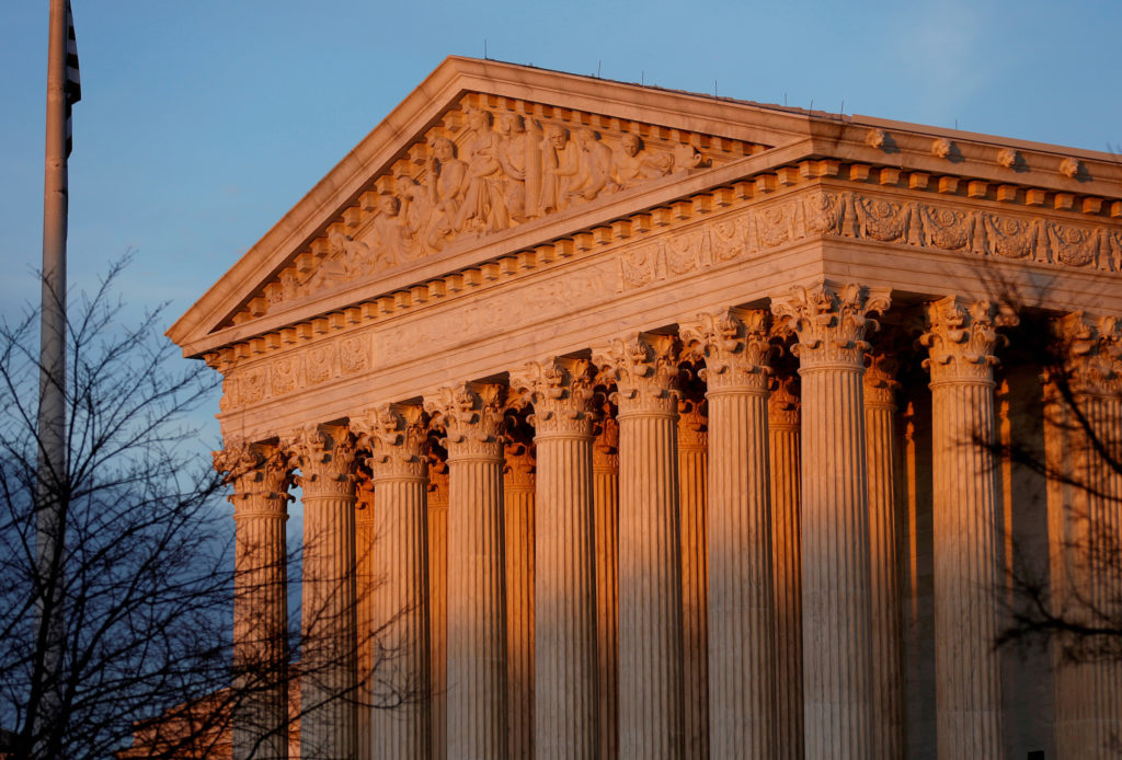 Light from the setting sun shines on the Supreme Court in Washington, D.C. Photo by Joshua Roberts/Reuters