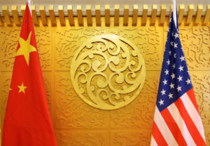 Chinese and U.S. flags are set up for a meeting during an April visit by U.S. Secretary of Transportation Elaine Chao at China's Ministry of Transport in Beijing, China. Photo by Jason Lee/Reuters