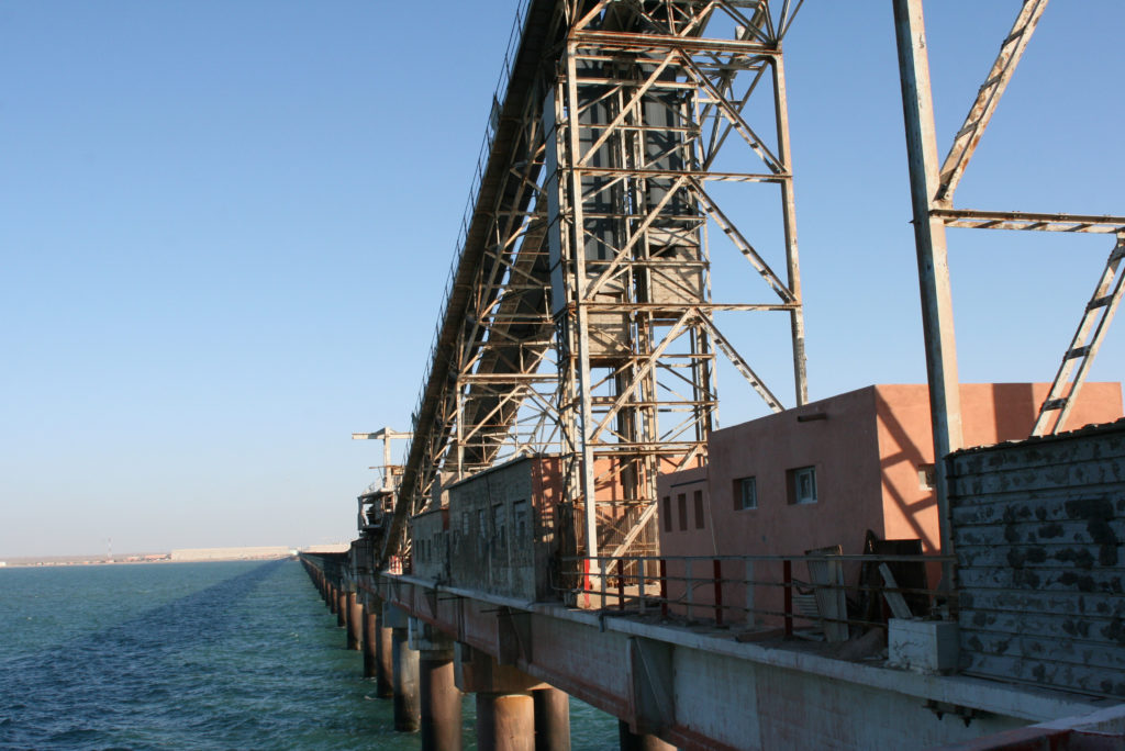 A conveyor belt carries phosphate rock to waiting ships at the Laayoune port. Photo by Larisa Epatko