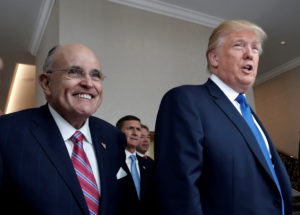 FILE PHOTO: Republican presidential nominee Donald Trump walks with former New York City Mayor Rudolph Giuliani (L) through the new Trump International Hotel in Washington, DC, U.S., September 16, 2016. REUTERS/Mike Segar/File Photo