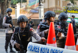 Police take position outside the Mobile Police Brigade (Brimob) headquarters in Depok, Indonesia, May 10, 2018. REUTERS/Darren Whiteside