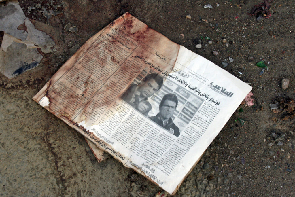 A bloodied newspaper on the grounds of the army headquarters in Baghdad shows traces of the suicide attack. Photo by Larisa Epatko