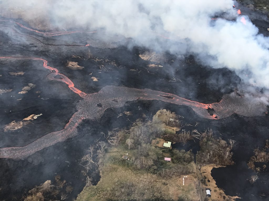 The lava channel emerging from Fissure 22 (not visible, but to the center, far right of the image). The lava is flowing downhill, from right to left in the photo. Photo by U.S. Geological Survey