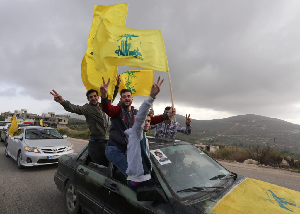 Supporters of Lebanon's Hezbollah leader Sayyed Hassan Nasrallah gesture as they hold Hezbollah flags in Marjayoun, Lebanon May 7, 2018. REUTERS/Aziz Taher
