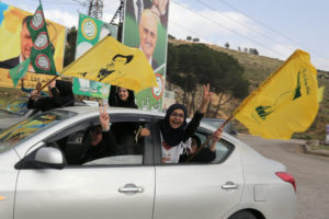 Supporters of Lebanon's Hezbollah gesture out of a car window in Marjayoun, Lebanon May 7, 2018. REUTERS/Aziz Taher