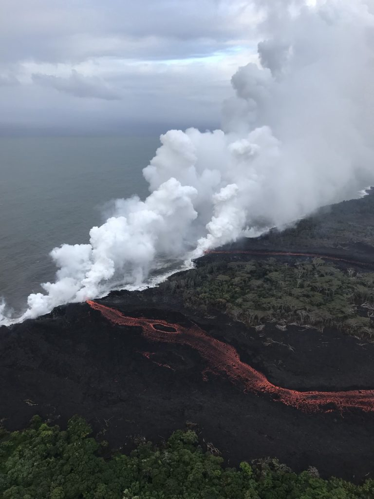 "Lava continued to enter the sea at two locations on the morning of May 21, 2018. The wind was blowing the ""laze"" plumes along the shoreline toward the southwest. Photo by U.S. Geological Survey"