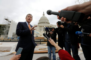 U.S. Senator Roy Blunt (R-MO), Chairman of the Joint Congressional Committee on Inaugural Ceremonies, speaks with reporters as they tour construction of the viewing stands ahead of U.S. President-elect Donald Trump's January inauguration at the U.S. Capitol in Washington, U.S., December 8, 2016. REUTERS/Jonathan Ernst - RC1235097B80
