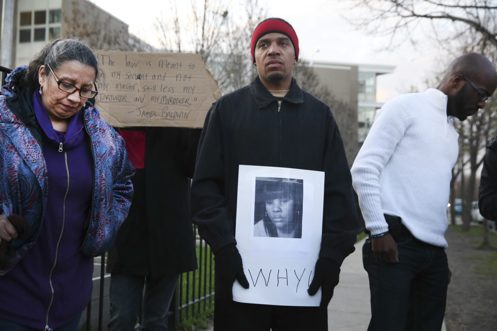 Donald Lightfoot holds a sign in support of Rekia Boyd while joining other protesters in Chicago. Photo taken April 2015. Photo by Nuccio DiNuzzo/Chicago Tribune/TNS via Getty Images