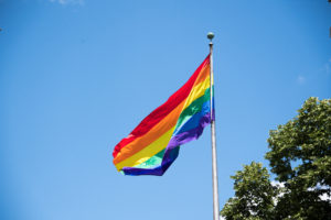 An gay pride flag waiving high in the air in Ontario, Canada. Photo by Roberto Machado Noa/LightRocket via Getty Images