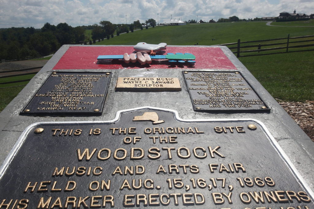 A plaque marks the original site location as the 40th anniversary of the Woodstock music festival in Bethel, New York. Photo taken in 2009. Photo by Mario Tama/Getty Images