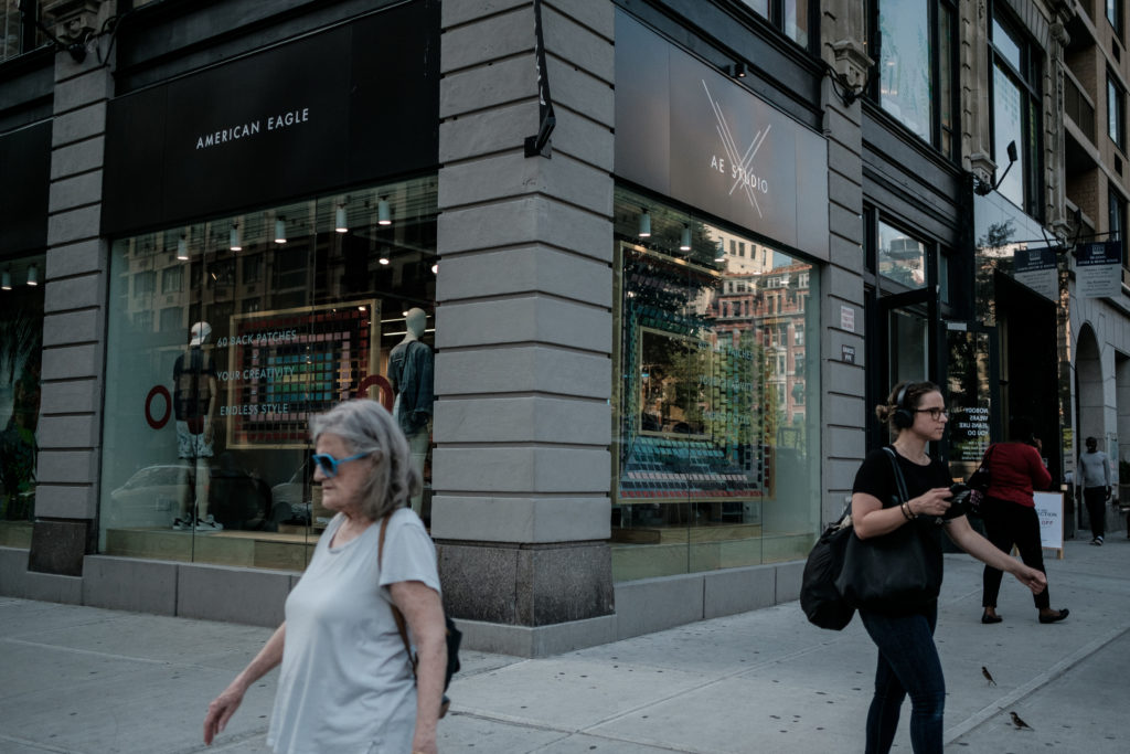 A pedestrian passes in front of an American Eagle Outfitters Inc. store in New York on Tuesday, May 29, 2018. The retail i...