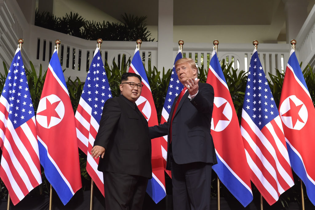 President Donald Trump gestures as he meets with North Korea's leader Kim Jong Un at the start of their US-North Korea summit on June 12, 2018. Photo by Saul Loeb/AFP/Getty Images