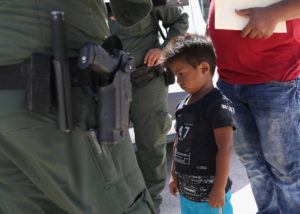 A boy and father from Honduras are taken into custody by U.S. Border Patrol agents near the U.S.-Mexico Border near Mission, Texas. President Donald Trump signed an executive order Wednesday ending family separation at the border. Photo by John Moore/Getty Images
