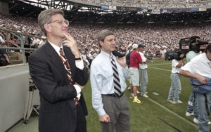 Penn State athletic director Tim Curley (L) and Penn State president Graham Spanier watch the Nittany Lions' football game against Texas Tech from the sidelines of Beaver Stadium in State College, Pennsylvania in this September 9, 1995 file photo. Photo by Craig Houtz/Files/Reuters