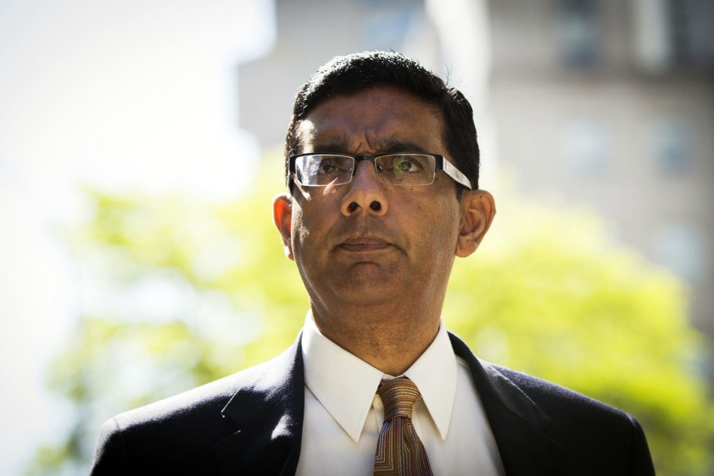 Conservative commentator Dinesh D'Souza exits the Manhattan Federal Courthouse after pleading guilty to making illegal contributions. Photo taken in 2014. Photo by Lucas Jackson/Reuters