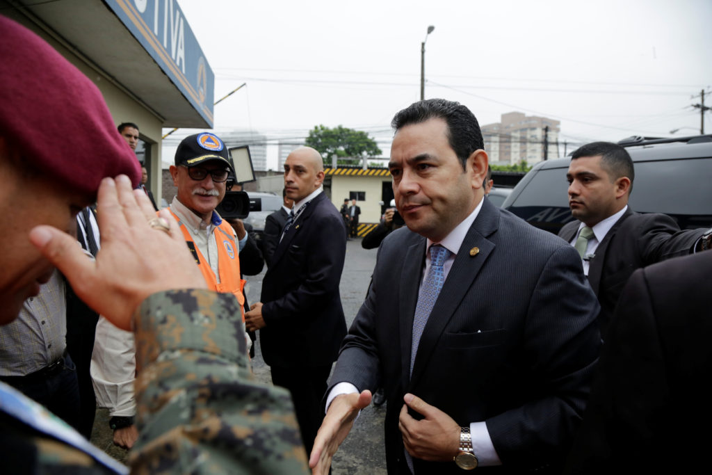 Guatemala's President Jimmy Morales arrives to the National Coordinator of Disaster Reduction to address the media following an earthquake, in Guatemala City