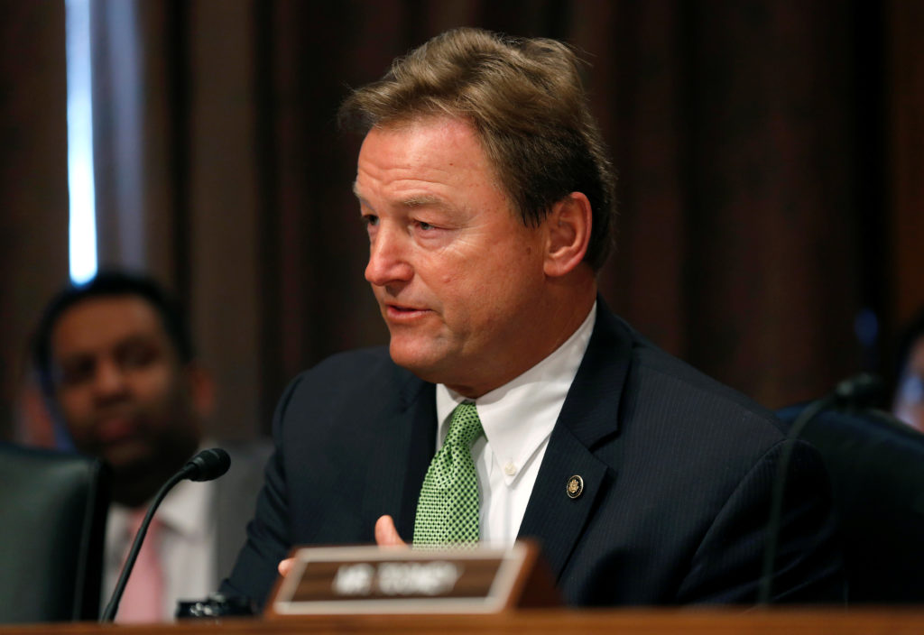 "Senator Dean Heller (R-NV) questions U.S. Treasury Secretary Steven Mnuchin as he testifies to the Senate Banking, Housing and Urban Affairs Committee on ""The Financial Stability Oversight Council Annual Report to Congress"" on Capitol Hill in Washington, U.S., January 30, 2018. REUTERS/Joshua Roberts - RC1EAF54E780"