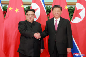 North Korean leader Kim Jong Un shakes hands with China's President Xi Jinping, in Dalian, China in this undated photo released on May 9, 2018 by North Korea's Korean Central News Agency (KCNA). Photo by KCNA via Reuters