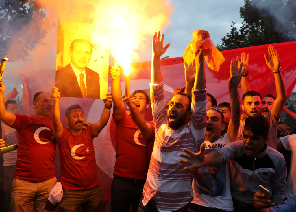 Supporters of Turkish President Tayyip Erdogan cheer in front of Turkey's ruling AK Party (AKP) headquarters in Istanbul