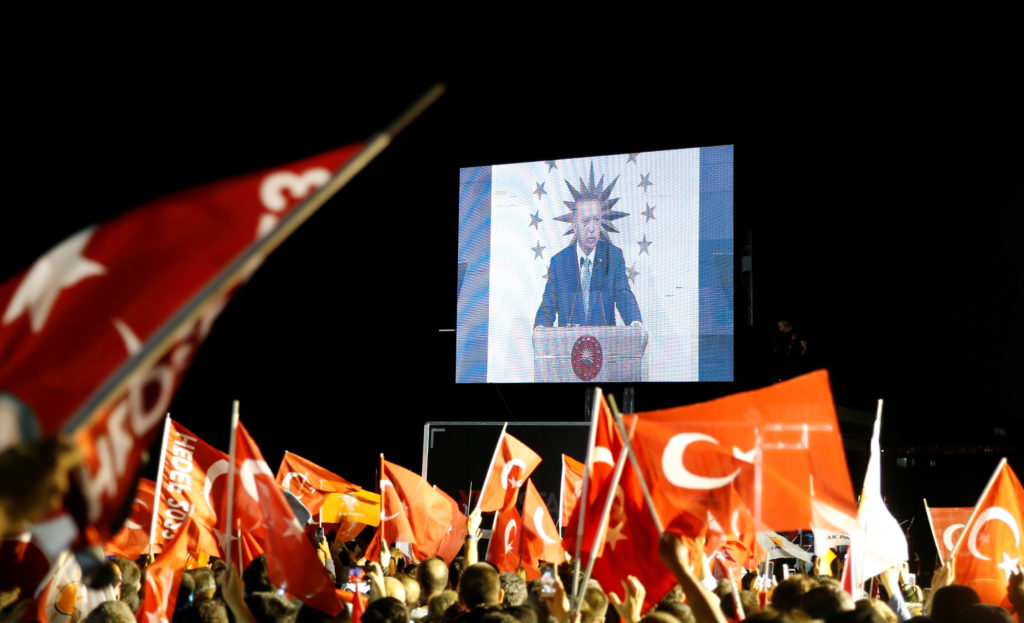 Turkish President Tayyip Erdogan is seen on the screen as he addresses his supporters in Istanbul