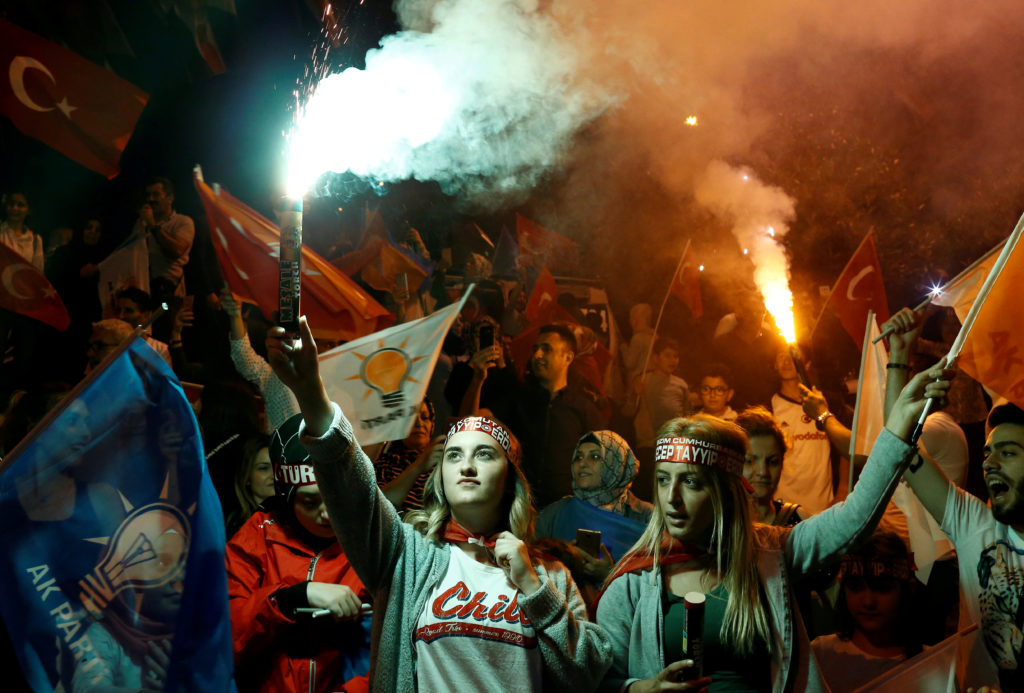 Supporters of AK Party celebrate outside the party's headquarters in Istanbul