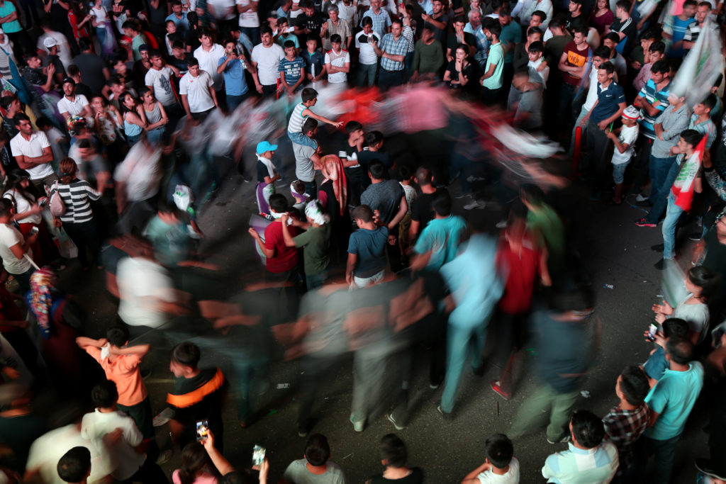 Supporters of pro-Kurdish HDP dance as they celebrate in Diyarbakir