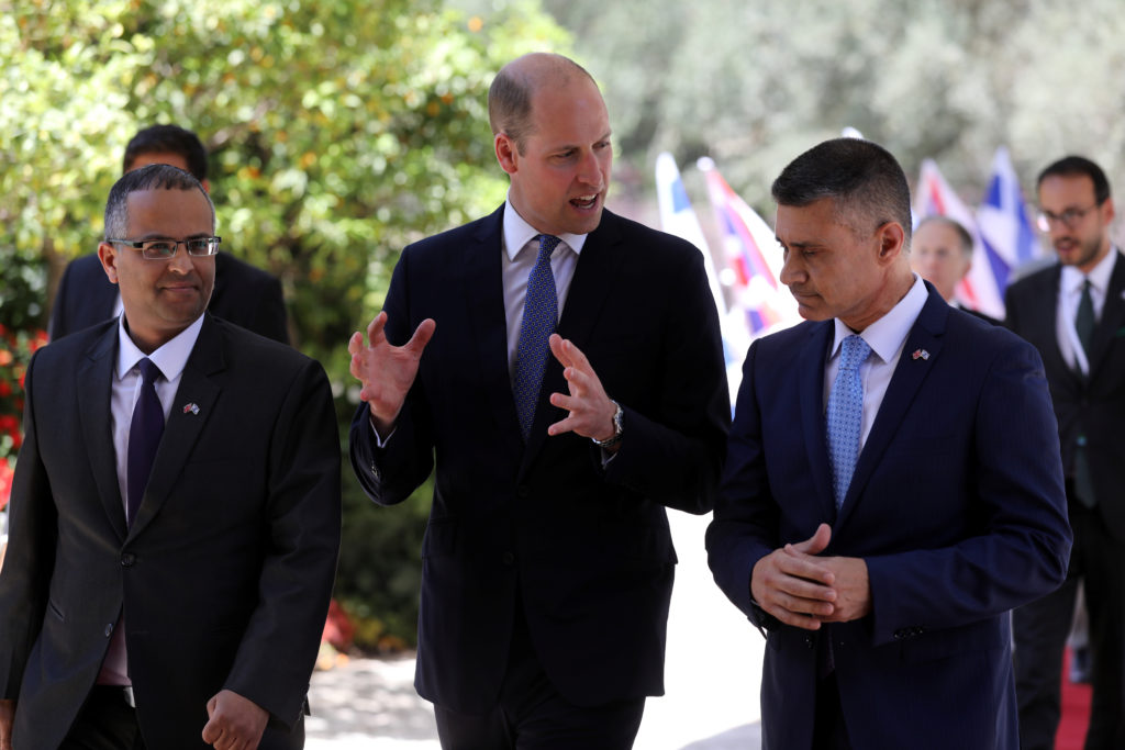 Britain's Prince William speaks with officials at the residence of Israeli President Reuven Rivlin in Jerusalem on June 26. Photo by Ammar Awad/Reuters