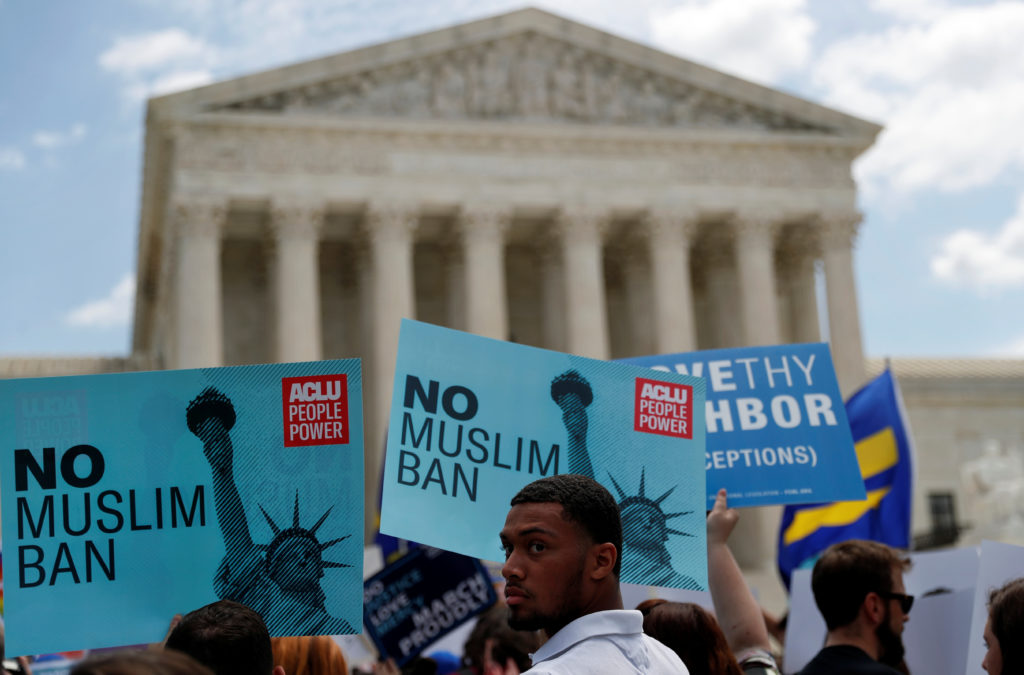 Protesters gather at the U.S. Supreme Court after it upheld President Donald Trump's travel ban on June 26. Photo by Leah ...