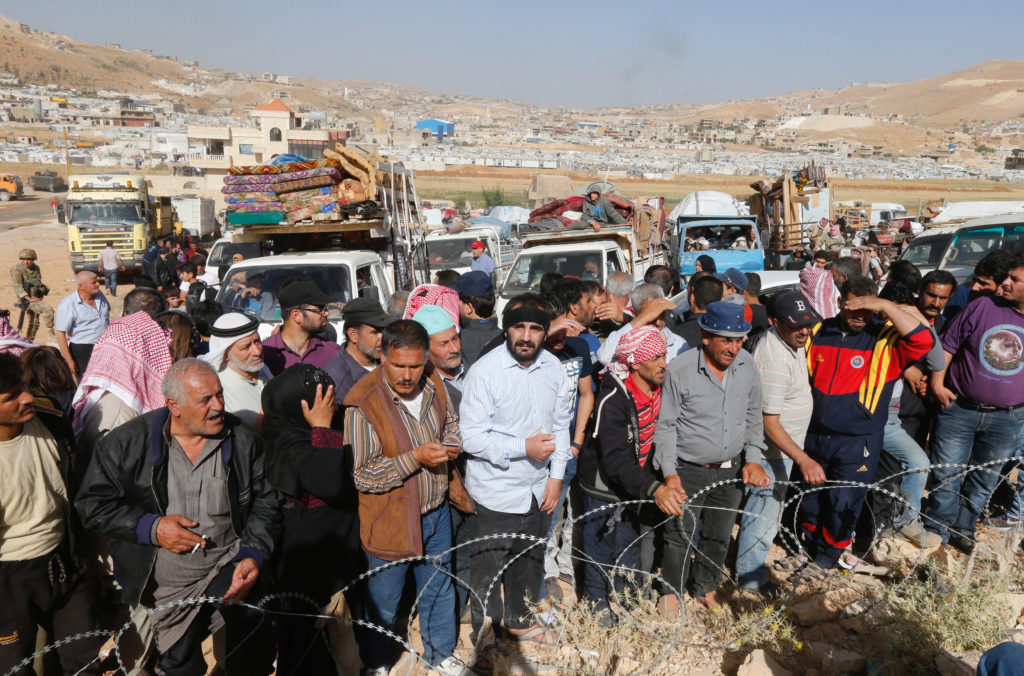 Syrian refugees prepare to return to Syria from the Lebanese border town of Arsal, Lebanon. Photo by Mohamed Azakir/Reuters