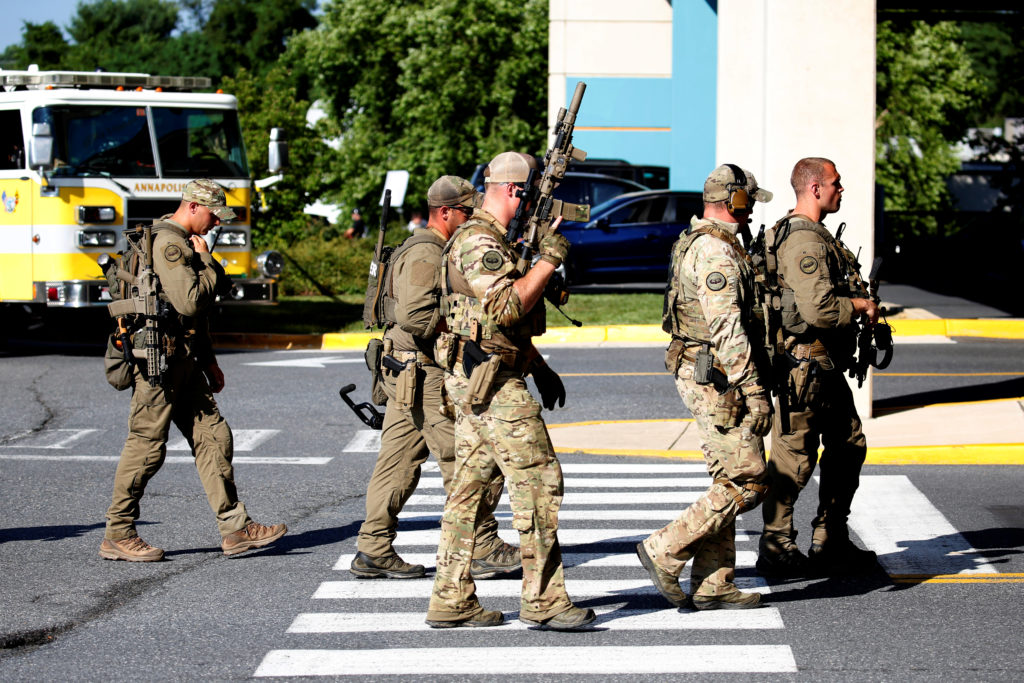 Special tactical police gather after a gunman opened fire at the Capital Gazette newspaper, killing at least five people in Annapolis, Maryland. Photo by Joshua Roberts/Reuters