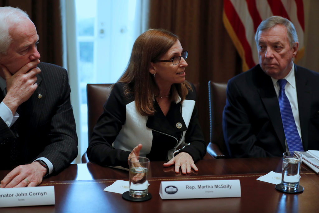 U.S. Representative Martha McSally (R-AZ), flanked by Senator John Cornyn (R-TX) and Senator Dick Durbin (D-IL), speaks as U.S. President Donald Trump holds a bipartisan meeting with legislators on immigration reform at the White House in Washington, D.C., on Jan. 9, 2018. Photo by Jonathan Ernst/Reuters