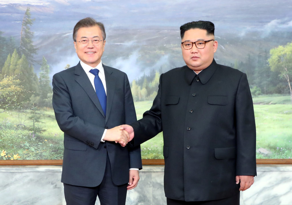 South Korean President Moon Jae-in shakes hands with North Korean leader Kim Jong Un during their May summit at the truce ...