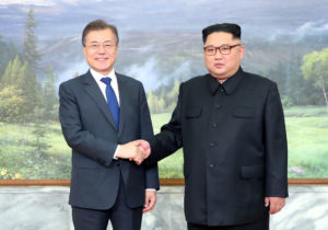 South Korean President Moon Jae-in shakes hands with North Korean leader Kim Jong Un during their May summit at the truce village of Panmunjom, North Korea, in this handout picture provided by the Presidential Blue House. Photo by The Presidential Blue House via Reuters