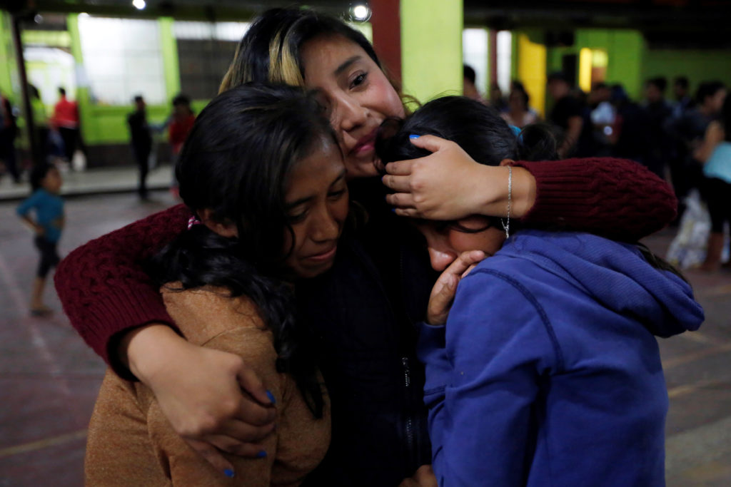 Women react inside a shelter after Fuego volcano erupted violently in San Juan Alotenango, Guatemala. Photo by Luis Echeverria/Reuters