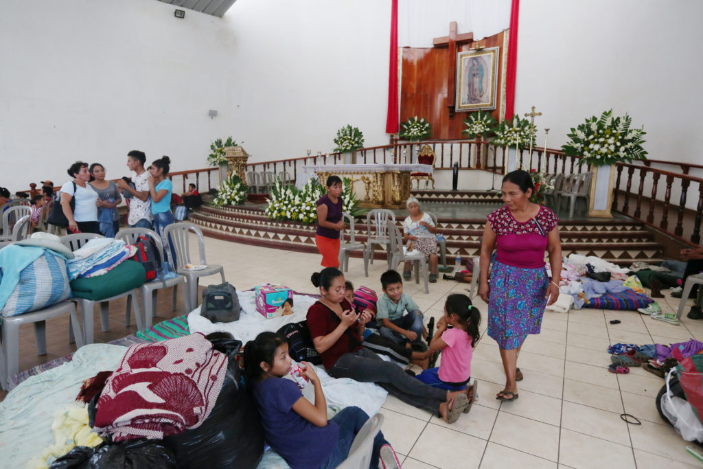 Victims gather inside a church used as a shelter after Fuego volcano erupted in Alotenango, Guatemala. Photo by Jose Cabezas/Reuters