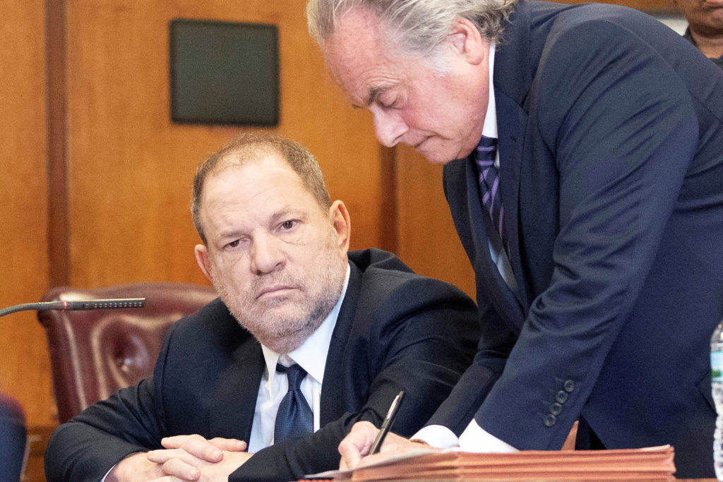 Film producer Harvey Weinstein sits with his lawyer Benjamin Brafman inside Manhattan Criminal Court during his indictment...