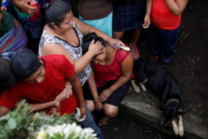 Relatives of Eric Rivas, 20, who died during the eruption of the Fuego volcano, mourn during his funeral in Alotenango, Guatemala June 6. Photo by Jose Cabezas/Reuters
