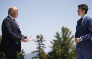 U.S. President Donald Trump approaches Canada's Prime Minister Justin Trudeau as he arrives at the G7 Summit in Charlevoix, Quebec, Canada, June 8, 2018. REUTERS/Leah Millis - HP1EE6819ZBXM