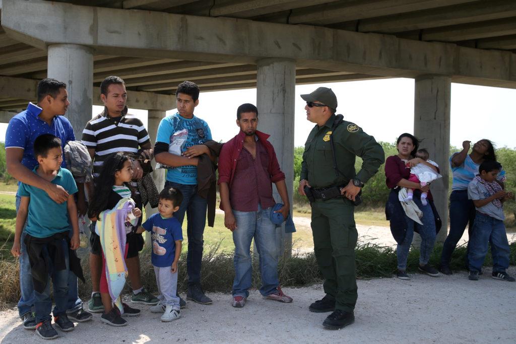 Border patrol agent Sergio Ramirez talks with immigrants who illega…
