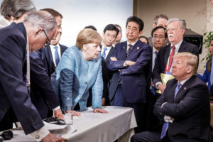 German Chancellor Angela Merkel speaks to U.S. President Donald Trump during the second day of the G7 meeting in Charlevoix city of La Malbaie, Quebec, Canada, June 9, 2018. Bundesregierung/Jesco Denzel via Reuters