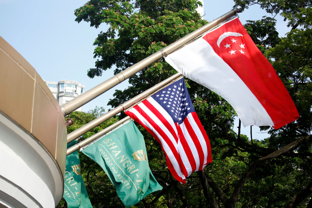 The Singapore and United States flags fly at the Shangri-La Hotel in Singapore. Photo by Feline Lim/Reuters