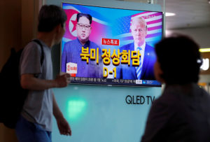 People watch a TV broadcasting a news report on the upcoming summit between the U.S. and North Korea, in Seoul, South Korea. Photo by Kim Hong-Ji/Reuters