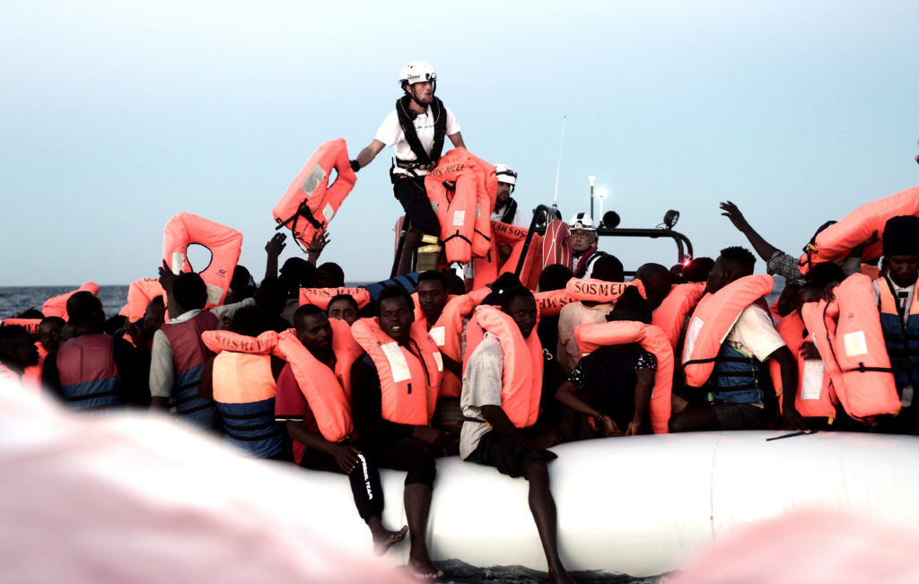 Migrants are rescued by staff members of the MV Aquarius, a search and rescue ship run in partnership between SOS Mediterranee and Medecins Sans Frontieres in the central Mediterranean Sea. Photo by Karpov via Reuters